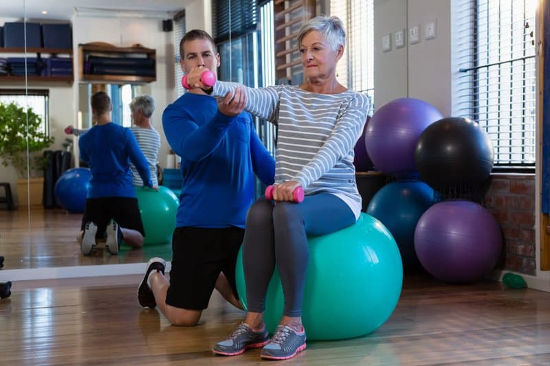 The exercise ball is thought to be effective in several rehabilitation programs due to its ability to strengthen and develop the core body muscles that help stabilize the spine.
