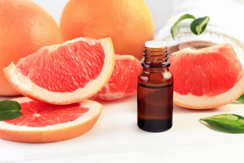 Oranges that are sliced and essential oil