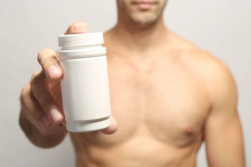 Man holding supplement bottle