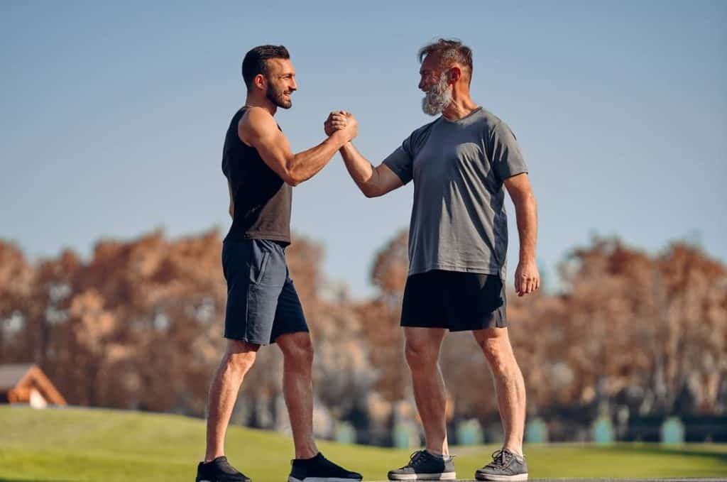two men exercising showing muscle