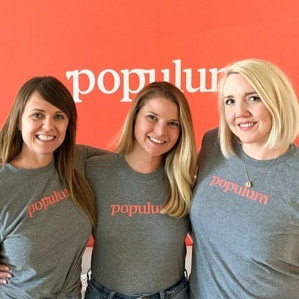 Girls wearing Populum brand t-shirts