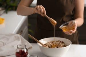 lady prepping oatmeal breakfast bars
