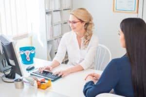 woman talking to fertility doctor